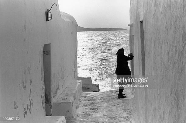 The Greek islands a vanishing world in Mykonos Greece in October 1988 Woman in morning