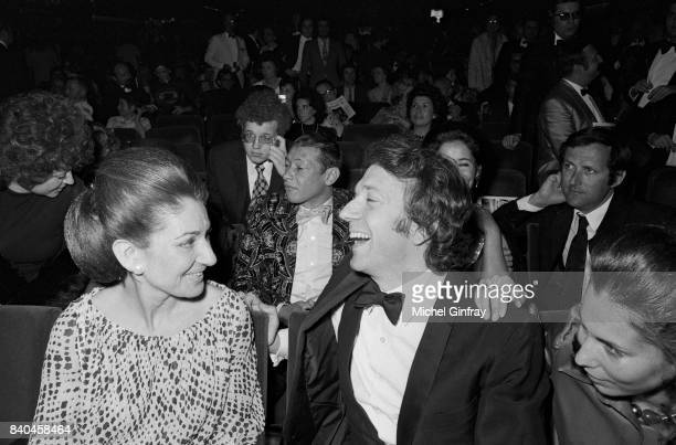 The Greek Opera singer Maria Callas sitting next to the french actor JeanPierre Cassel and with Henri Salvador in the background at the première of...