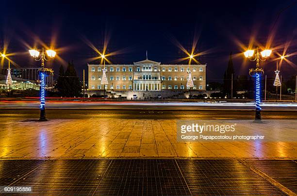 the greek parliament at night - greek parliament stock pictures, royalty-free photos & images