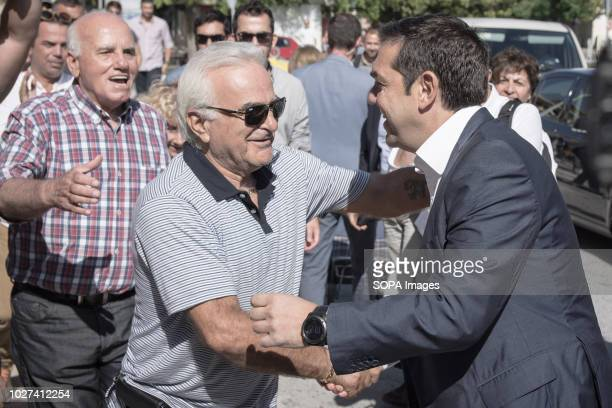 The Greek Prime Minister Alexis Tsipras seen hagging with an elderly man during his visit The Greek Prime Minister Alexis Tsipras visits Chania He...