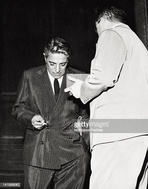 The Greek shipowner Aristoteles Onassis is interviewed by a journalist after the news of Maria Callas's separation from her husband Italy 1959