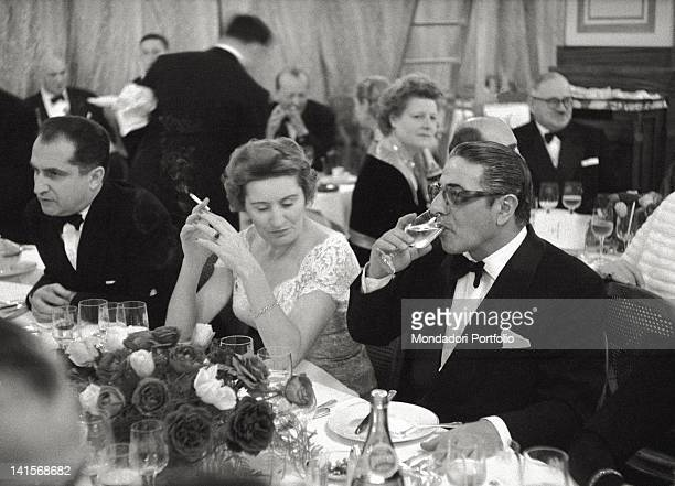 The Greek shipowner Aristotle Onassis to an elegant dinner in a big restaurant in Montecarlo by that time his official residence Onassis docked his...
