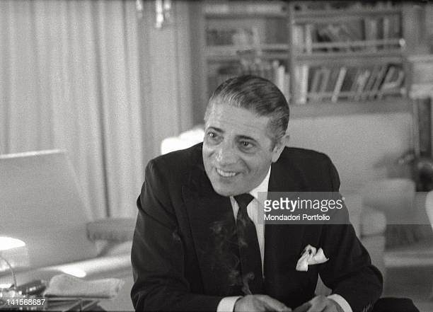 The Greek shipowner Onassis interviewee in a luxury room of his yacht originally a Canadian fregate of the II World War converted in a luxury yacht...