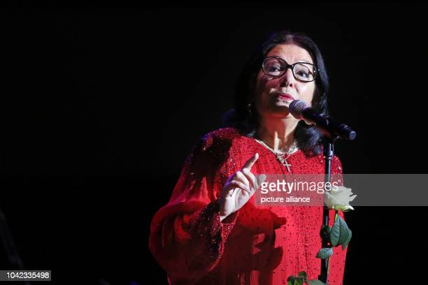 The Greek singer Nana Mouskouri sings during the opening concert of her Birthday tour in the Gewandhaus in Leipzig Germany 2 October 2014 The singer...