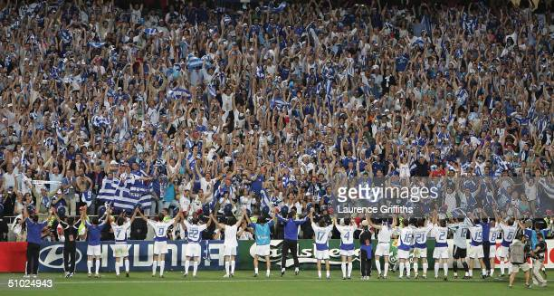 The Greek team celebrate to the fans after winning the UEFA Euro 2004 Final match between Portugal and Greece at the Luz Stadium on July 4 2004 in...