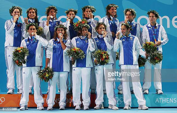 The Greek team celebrate with their silver medals after being beaten in extra time by Italy in the women's Water Polo gold medal game betwen Greece...
