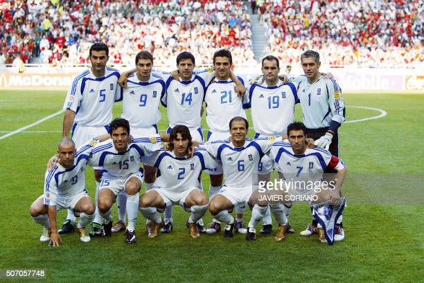 The Greek team pose for the press, 04 July 2004 at the Luz stadium in Lisbon, prior to the Euro 2004 final match between Portugal and Greece at the...