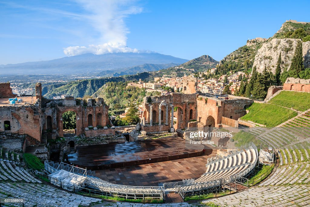 the greek theatre and mount etna taormina sicily stock
