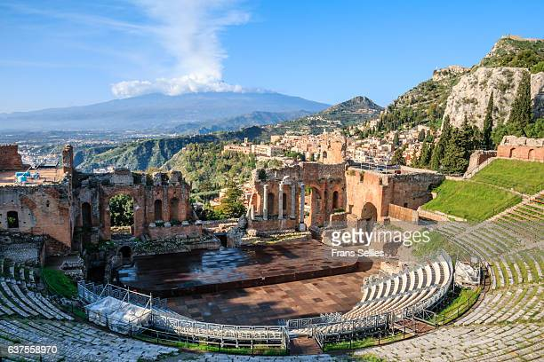 the greek theatre (teatro greco) and mount etna, taormina, sicily - sicilia foto e immagini stock