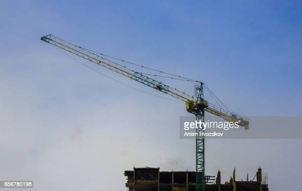 The green and yellow Construction Crane Boom