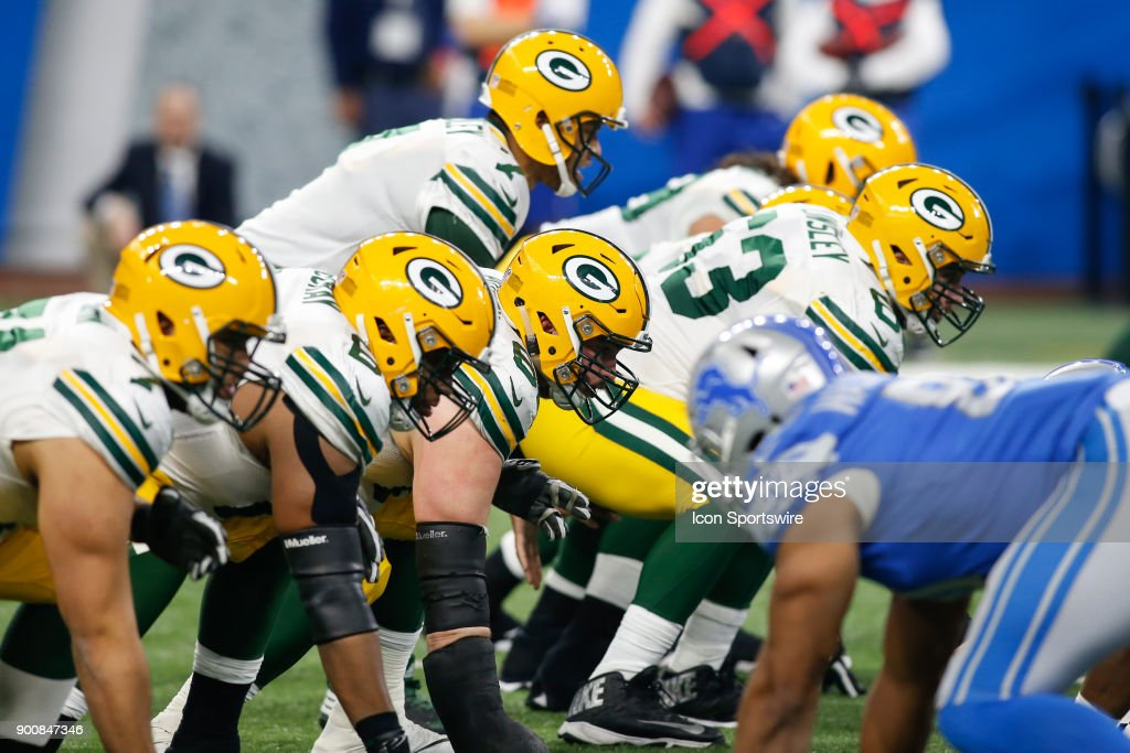 The Green Bay offensive line waits for the ball to be snapped during a game between the Green Bay Packers and the Detroit Lions on December 31, 2017 at Ford Field in Detroit, Michigan.