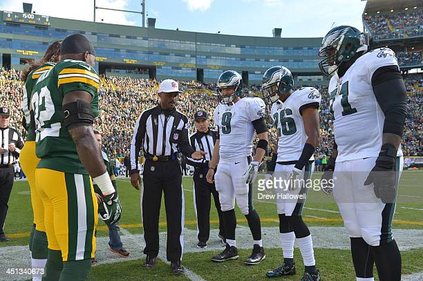 The Green Bay Packers and Philadelphia Eagles watch the coin toss at Lambeau Field on November 10 2013 in Green Bay Wisconsin