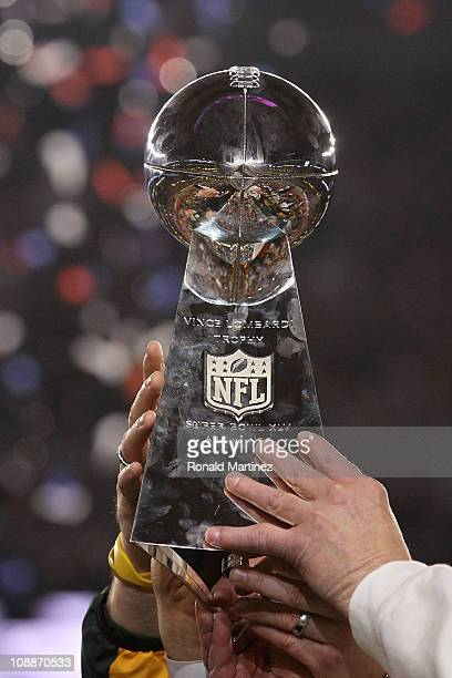 The Green Bay Packers hold up The Vince Lombardi Trophy after the defeating the Pittsburgh Steelers 31 to 25 in Super Bowl XLV at Cowboys Stadium on...