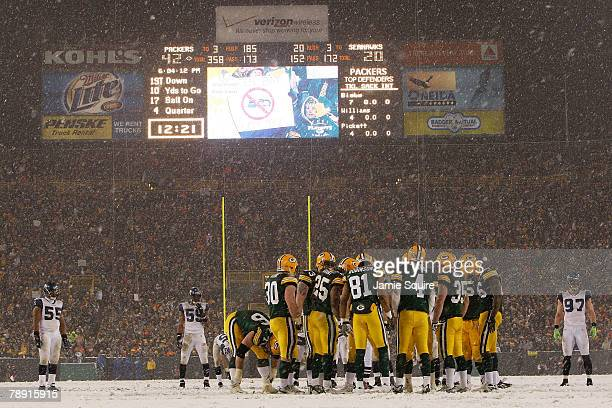 The Green Bay Packers huddle in the fourth quarter against the Seattle Seahawks with a 4220 lead during the NFC divisional playoff game on January 12...