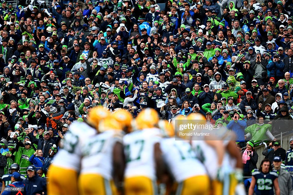 The Green Bay Packers huddle in the fourth quarter of the 2015 NFC Championship game against the Seattle Seahawks at CenturyLink Field on January 18, 2015 in Seattle, Washington.