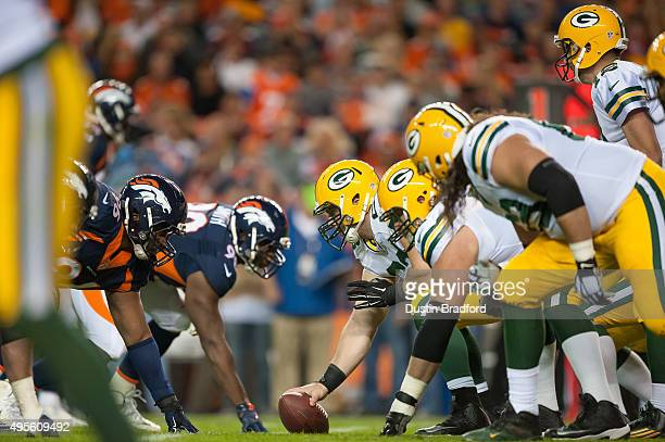 The Green Bay Packers line up on offense with Corey Linsley at center against the Denver Broncos at Sports Authority Field at Mile High on November 1...