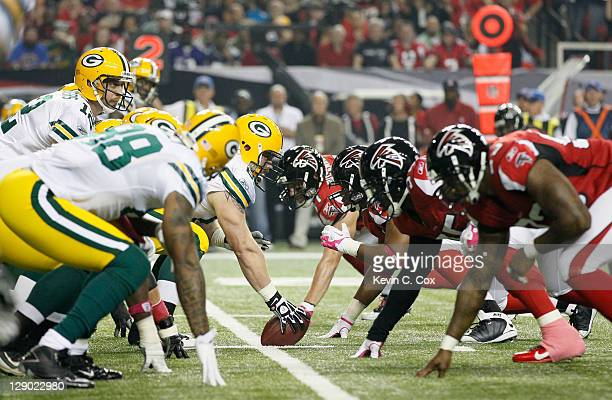 The Green Bay Packers line up with the Atlanta Falcons on the line of scrimmage at Georgia Dome on October 9, 2011 in Atlanta, Georgia.