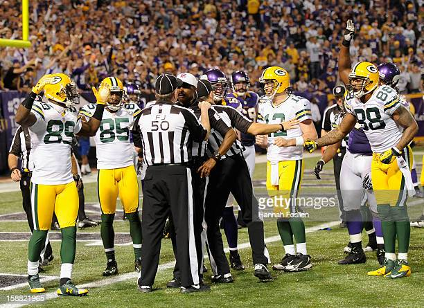 The Green Bay Packers react as field judge Mike Weir speaks with referee Mike Carey after a questionable play in the third quarter of the game...