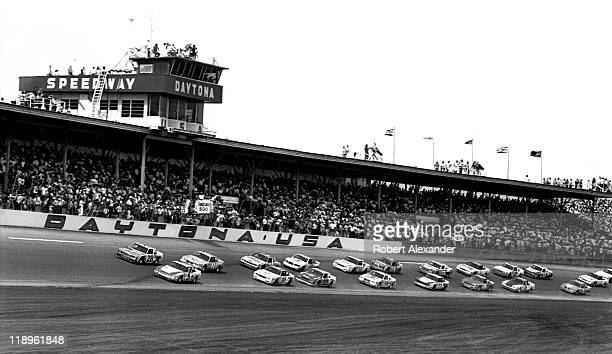 The green flag signals the start of the 1985 Daytona 500 on February 17 1985 at the Daytona International Speedway in Daytona Beach Florida