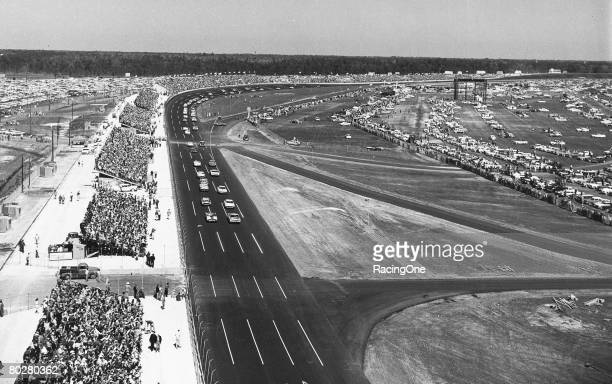 The green flag starts the first Daytona 500 Lee Petty driving a '59 Oldsmobile beat Johnny Beauchamp's '59 Ford Thunderbird by inches to take the...