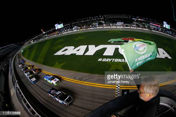 The green flag waves at the start of the NASCAR Gander Outdoors Truck Series NextEra Energy 250 at Daytona International Speedway on February 15 2019...