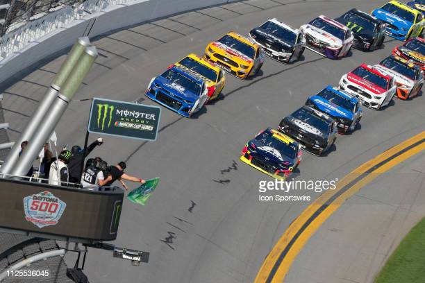 The green flag waves to start the Daytona 500 on February 17 2019 at Daytona International Speedway in Daytona Beach Fl