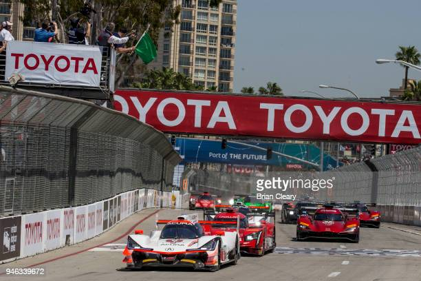 The green flag waves to start the IMSA Bubba Burger Grand Prix of Long Beach on April 14 2018 in Long Beach California