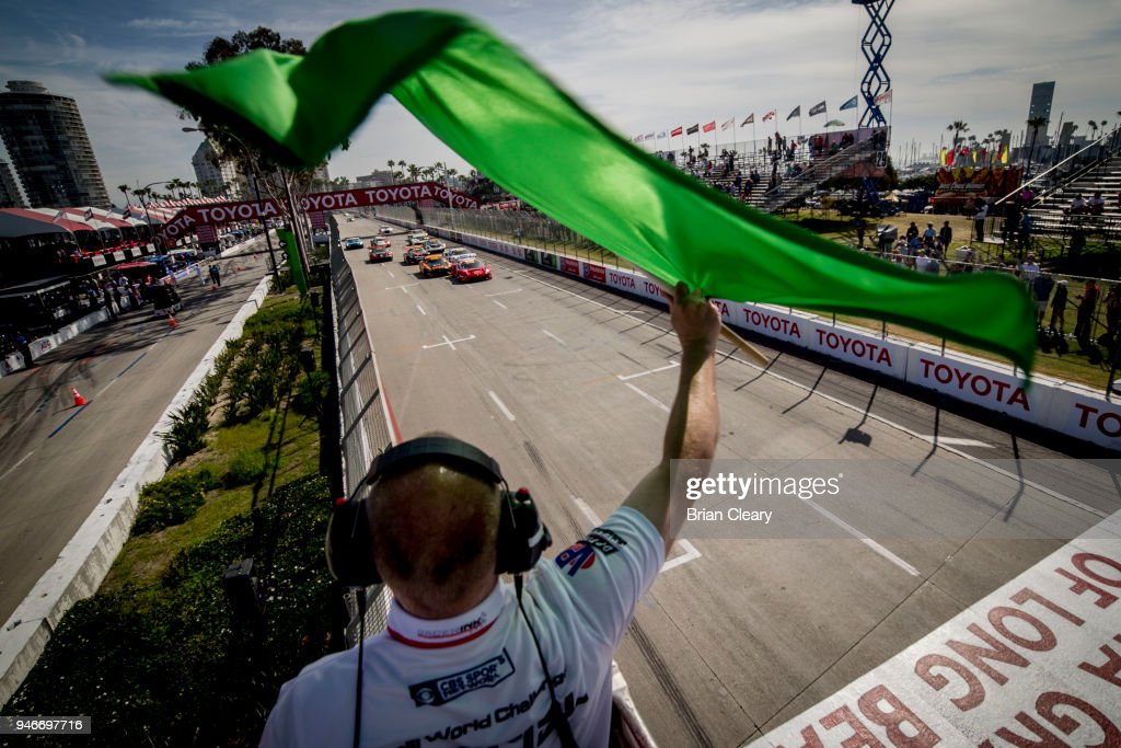 The green flag waves to start the Pirelli World Challenge GT race at the Toyota Grand Prix of Long Beach on April 15, 2018 in Long Beach, California.