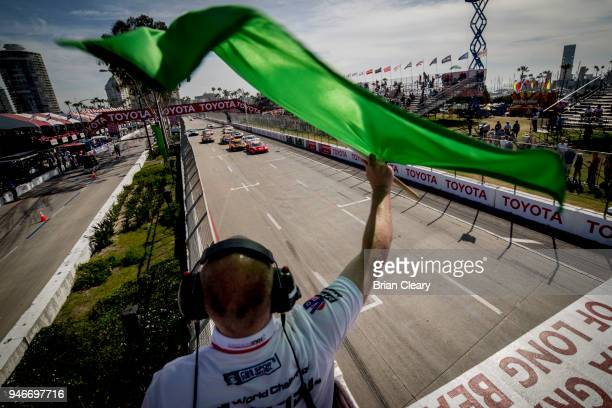 The green flag waves to start the Pirelli World Challenge GT race at the Toyota Grand Prix of Long Beach on April 15 2018 in Long Beach California