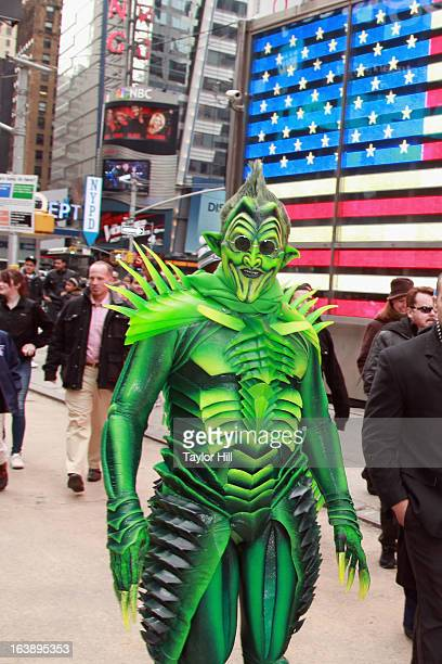 The Green Goblin takes a stroll through Times Square for the SpiderMan Turn off The Dark St Patrick's Day Celebration on March 17 2013 in New York...