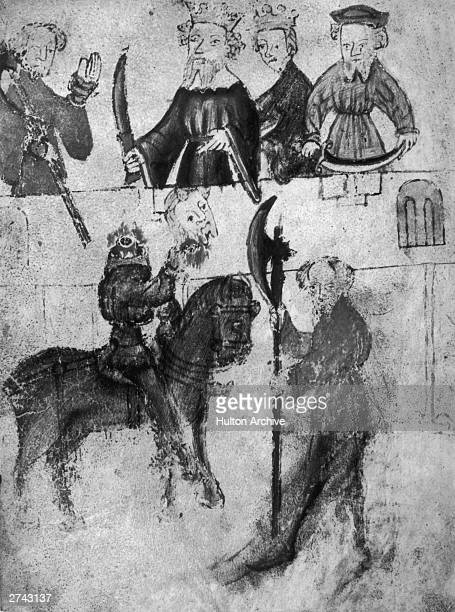 The Green Knight shows his severed head to King Arthur in an illustration depicting a scene from the fourteenth century legend of Gawain And The...