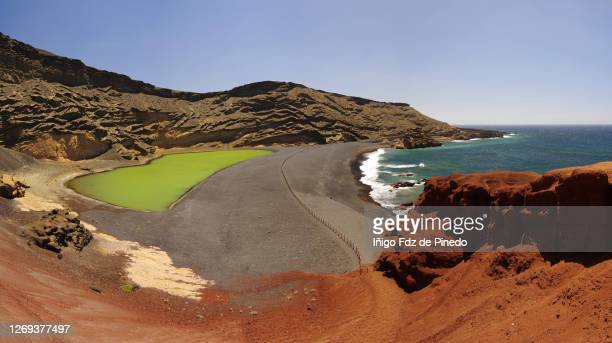 the green lagoon in lanzarote - el gofo, canary islands, spain. - black sand stock pictures, royalty-free photos & images