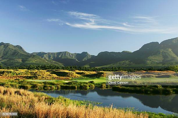 The green looking towards the mountains on the 425 metre par 4, 15th hole on the Links Course at Fancourt, on February 25 in George, South Africa.