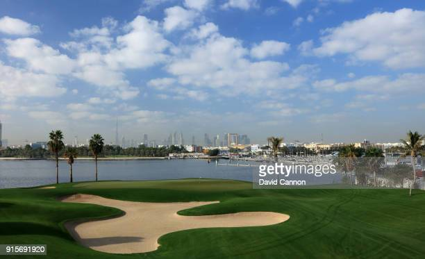 The green on the par 3 fifh hole with a view across The Dubai Creek with the Floating Bridge to the right and the Burj Khalifa in the distance behind...