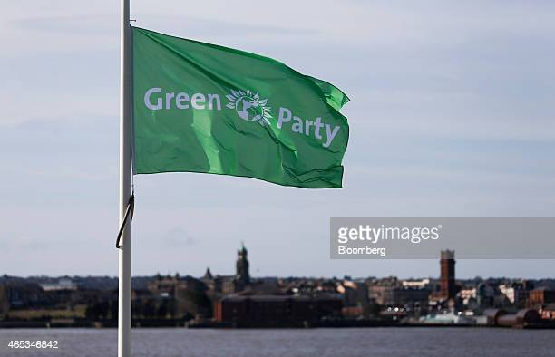 The Green Party logo sits on a flag as it flies beside the River Mersey during the party's spring conference in Liverpool UK on Friday March 6 2015...