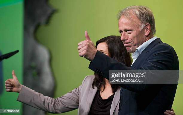 The Green Party's main candidate in parliamentary elections Juergen Trittin and cocandidate Katrin GoeringEckhardt acknowledge the applause during a...