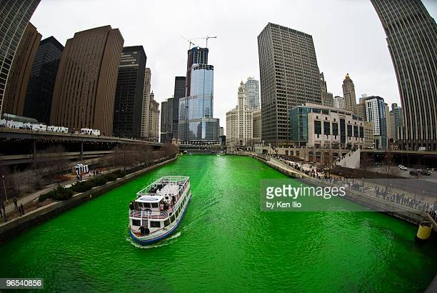 the greening of the chicago river   - st patricks day stock pictures, royalty-free photos & images