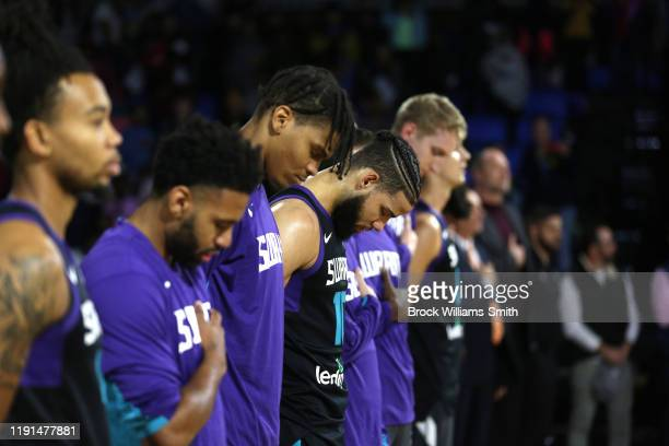 The Greensboro Swarm lines up for the national anthem before the game against the Westchester Knicks at The Fieldhouse on November 13, 2019 in...