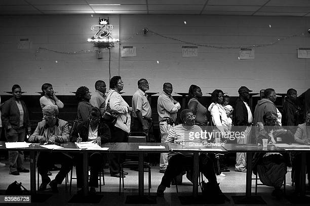 The Greenville MS community waits in line and votes inside the Elk Lodge Voting Polls on November 4 2008 in Greenville Mississippi Greenville lies in...