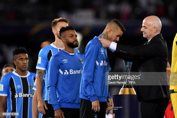 The Gremio team collect their medals from Gianni Infantino FIFA president during the FIFA Club World Cup UAE 2017 Final between Gremio and Real...