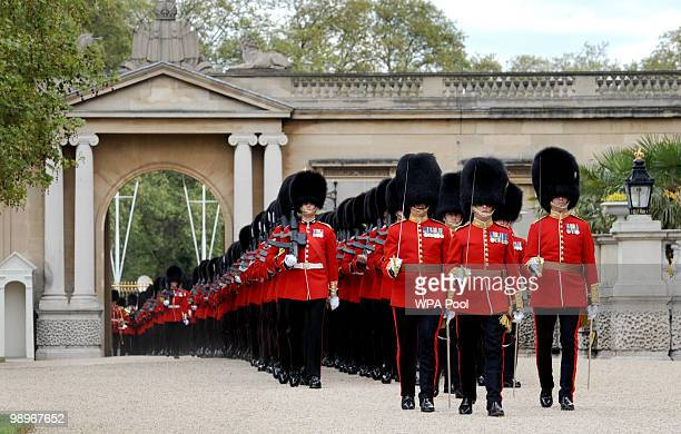 The Grenadier Guards march into Buckingham Palace before Queen Elizabeth II presented the 1st Battalion the Grenadier Guards with new regimental...