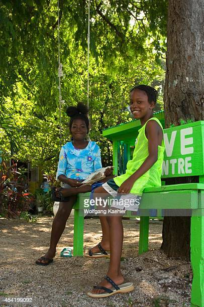 The Grenadines Bequia Island Port Elizabeth Street Scene Girls On Bench