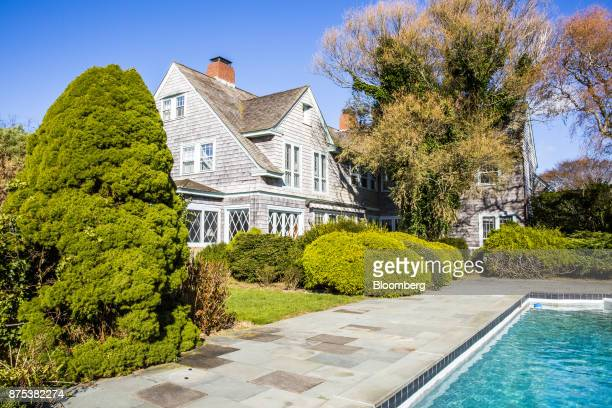 The Grey Gardens house and pool are seen at the estate in East Hampton New York US on Friday Nov 17 2017 Grey Gardens was the home of Jackie...