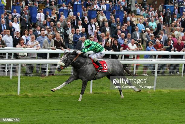 The Grey Gatsby ridden by Ryan Moore wins The Betfred Dante Stakes during day two of the Dante Festival at York Racecourse