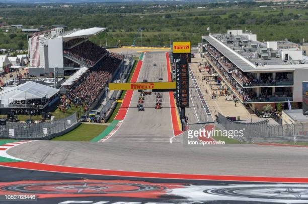 The grid comes to life at the start of the F1 United States Grand Prix on October 21 at Circuit of the Americas in Austin TX