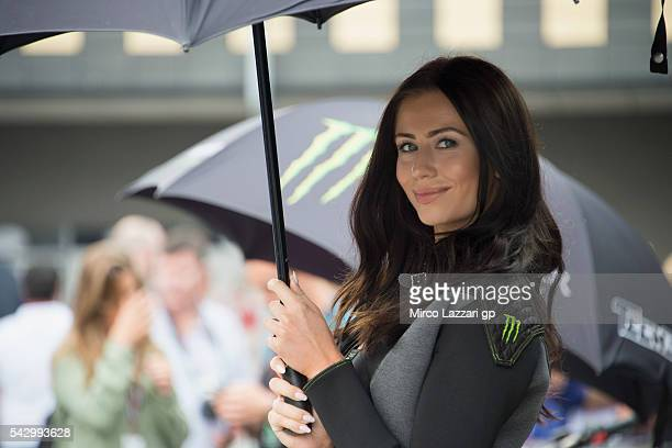 The grid girl smiles in paddock during the qualifying practice during the at MotoGP Netherlands Qualifying on June 25 2016 in Assen Netherlands