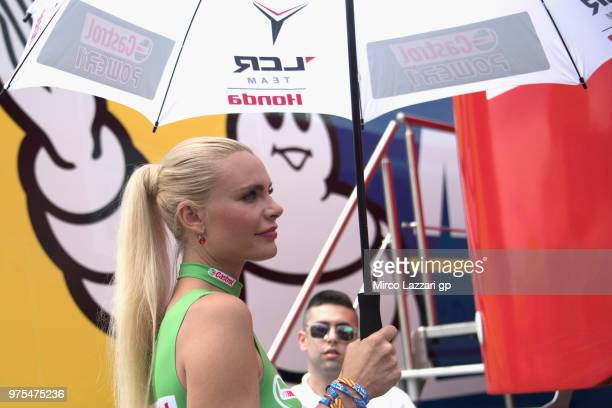 The grid girl walks in paddock with fans during the MotoGp of Catalunya Free Practice at Circuit de Catalunya on June 15 2018 in Montmelo Spain