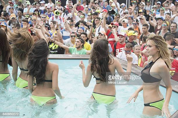 The grid girls play in the swimming pool during the event in Monster Energy during the MotoGp of Catalunya Free Practice at Circuit de Catalunya on...