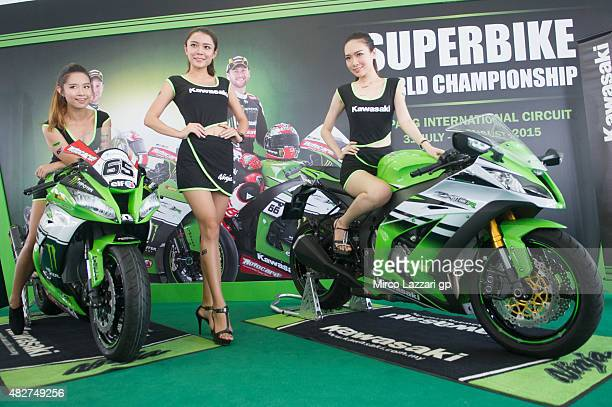 The grid girls pose in paddock before the Race 1 during the FIM Superbike World Championship Race at Sepang Circuit on August 2 2015 in Kuala Lumpur...
