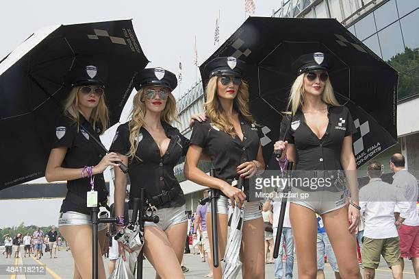 The grid girls pose in paddock during the MotoGp of Czech Republic Qualifying at Brno Circuit on August 15 2015 in Brno Czech Republic